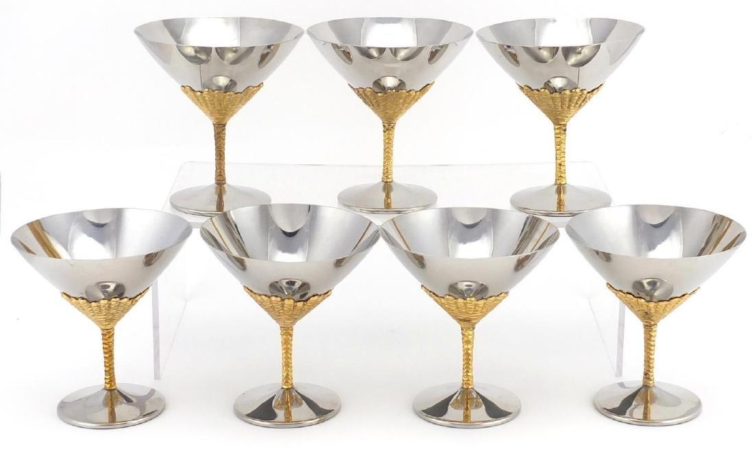 Seven Viners stainless steel cocktail glasses designed by Stuart Devlin, each 11.5cm high