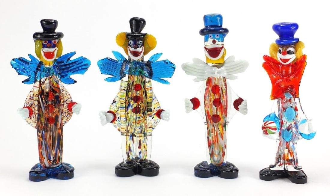 Four large Murano colourful glass clowns, including one with a ball, the largest 32.5cm high