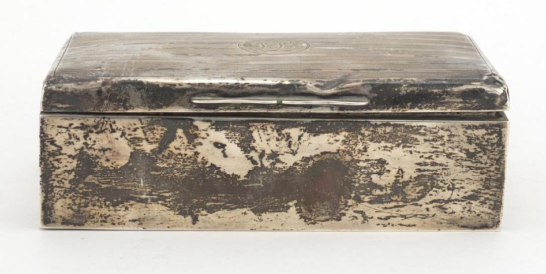Large rectangular silver cigar box, the hinged lid with engine turned decoration, indistinct
