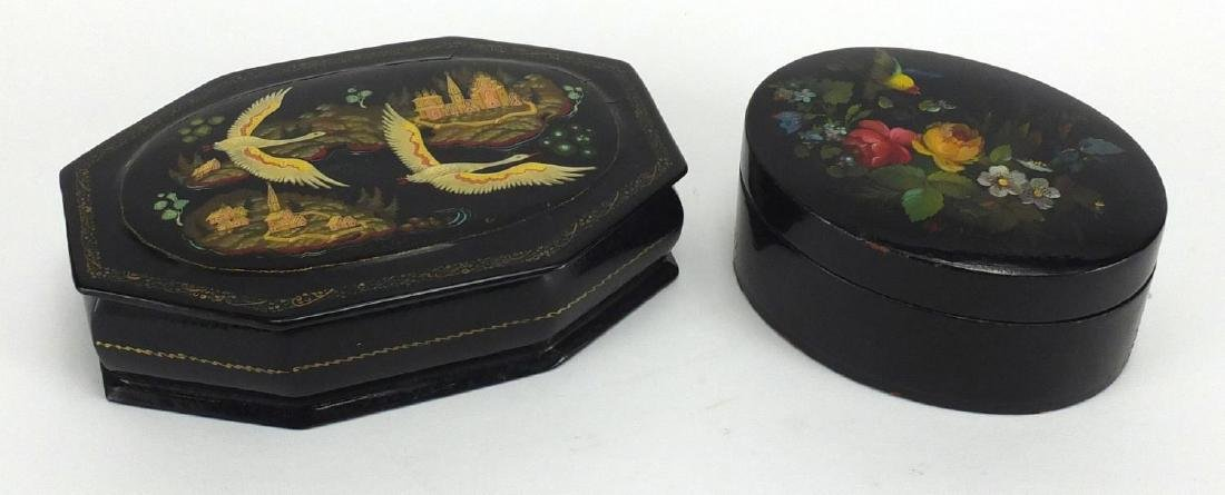 Two Russian lacquered boxes, one hand painted with birds in flight the other with flowers, the