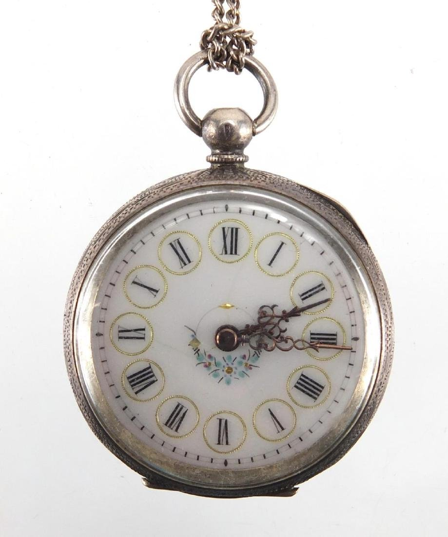 Ladies silver open face pocket watch with ornate dial and floral chased case, 3.5cm in diameter,