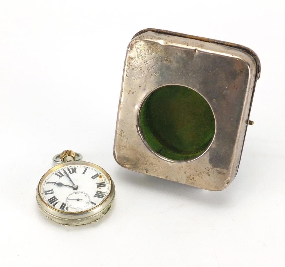 Rectangular silver easel pocket watch stand, housing a gentleman's oversized pocket watch with eight