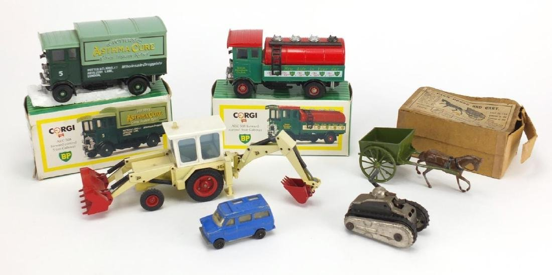 Vintage toys including Britain's farm horse and cart with box, NZG German tractor and Schuco