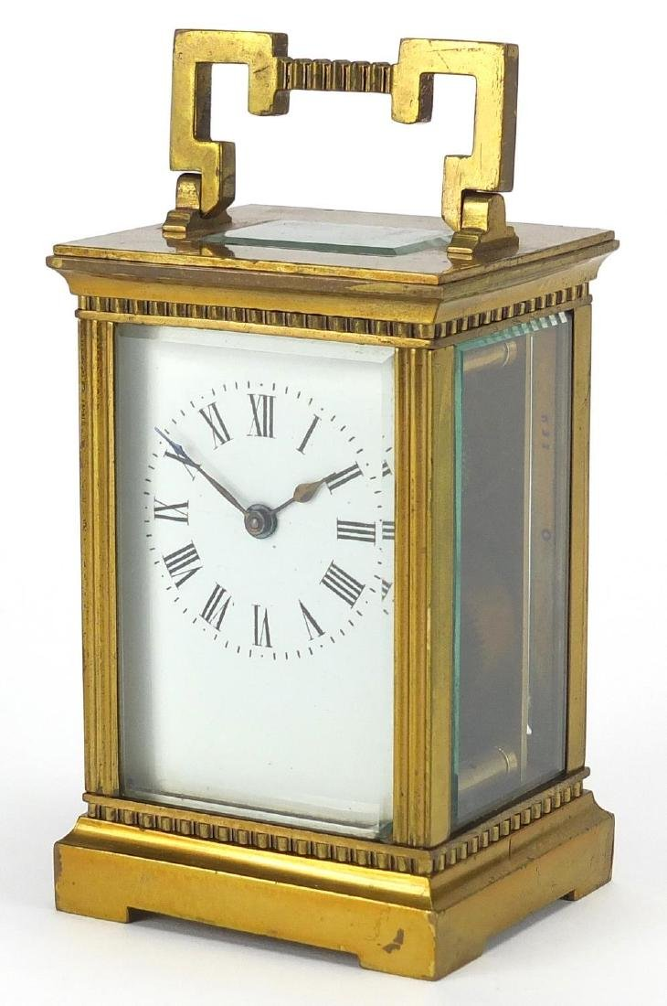 Brass cased carriage clock with bevelled glass, enamelled dial and Roman numerals, 11.5cm high
