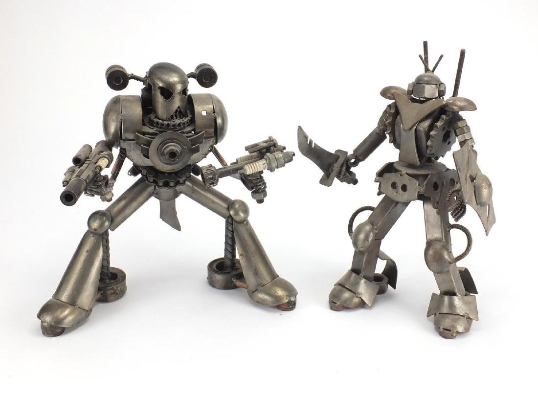 Two nut and bolt design metal robots, the largest 32cm high