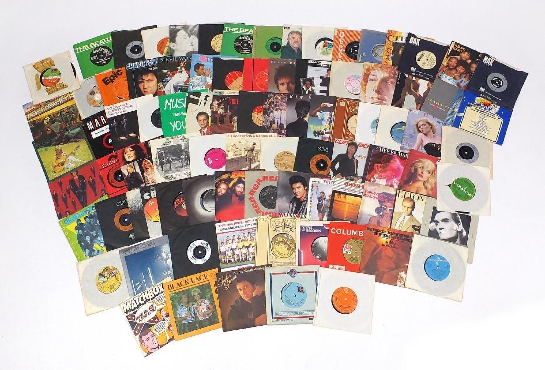 Vinyl 7inch singles including The Beatles, John Lennon, Vertigo Swirl, The Hollies and Showaddywaddy