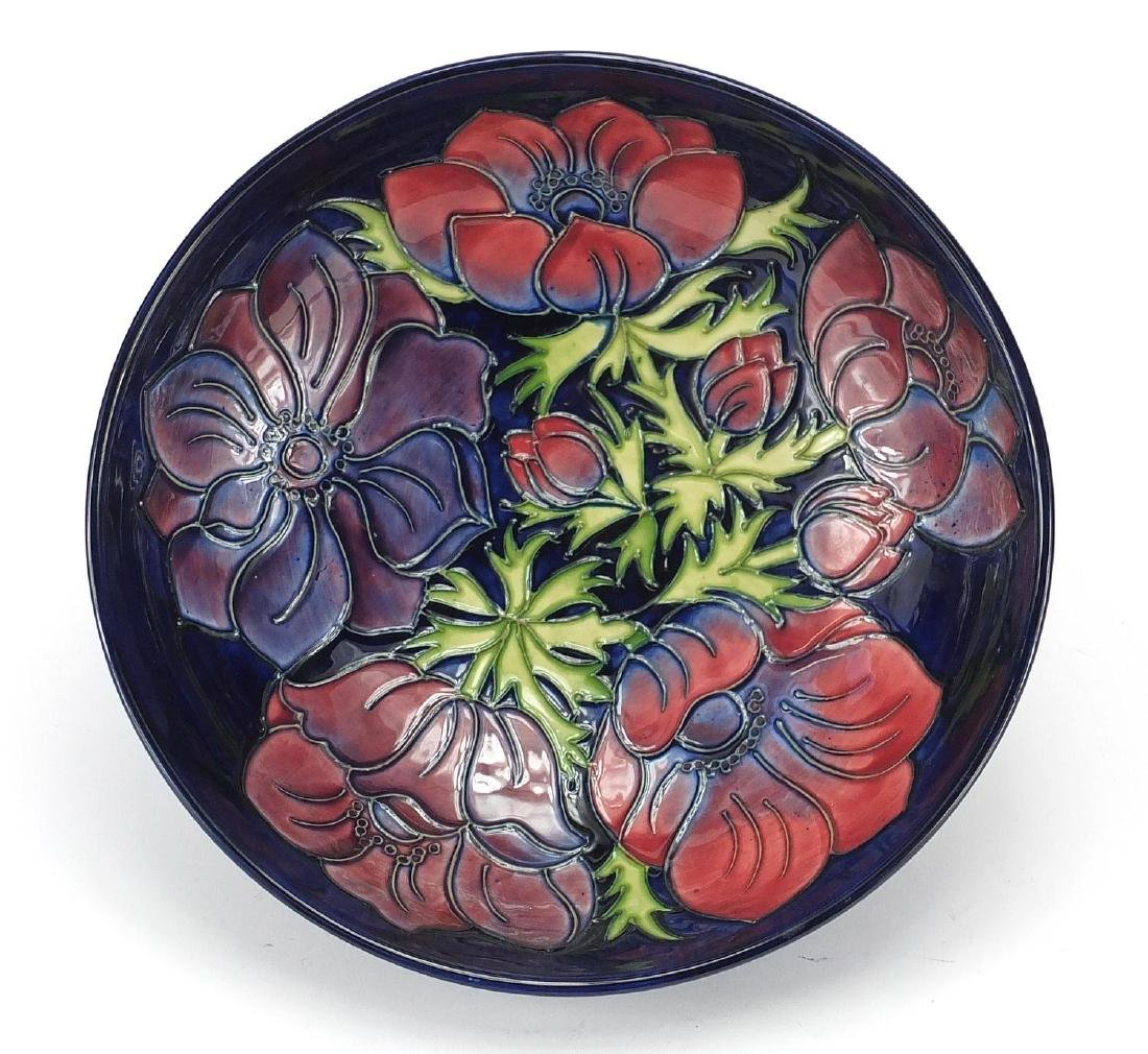 Moorcroft pottery bowl, hand painted and tube lined with flowers, factory marks and dated '94 to the