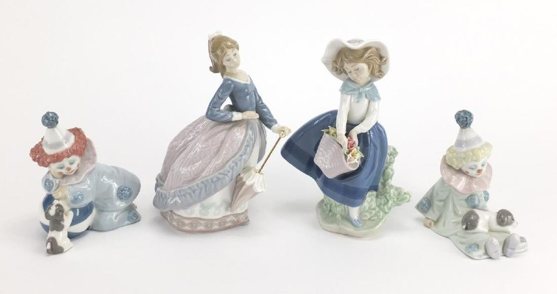 Four Lladro figures including two clowns and a girl with a basket of flowers, the largest 18cm