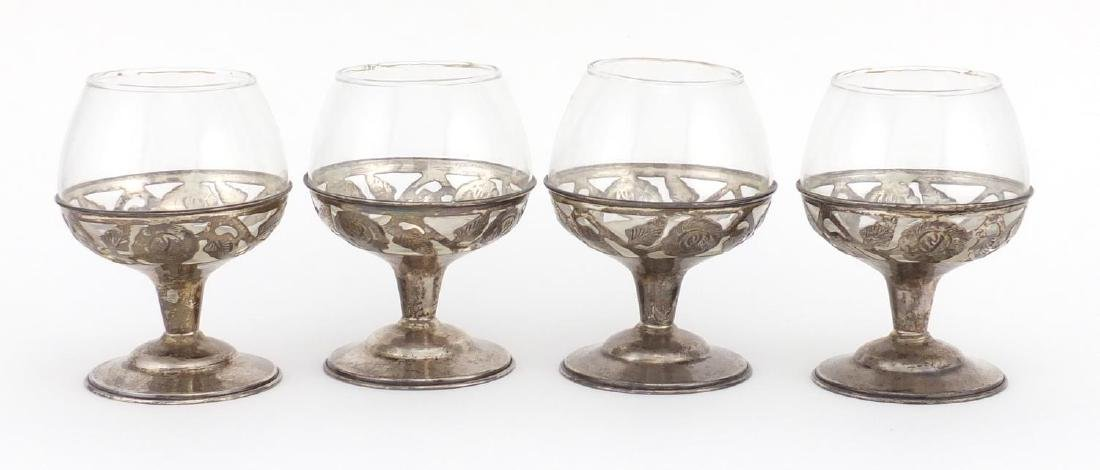 Set of four silver mounted brandy glasses, each stamped 925, 9cm high