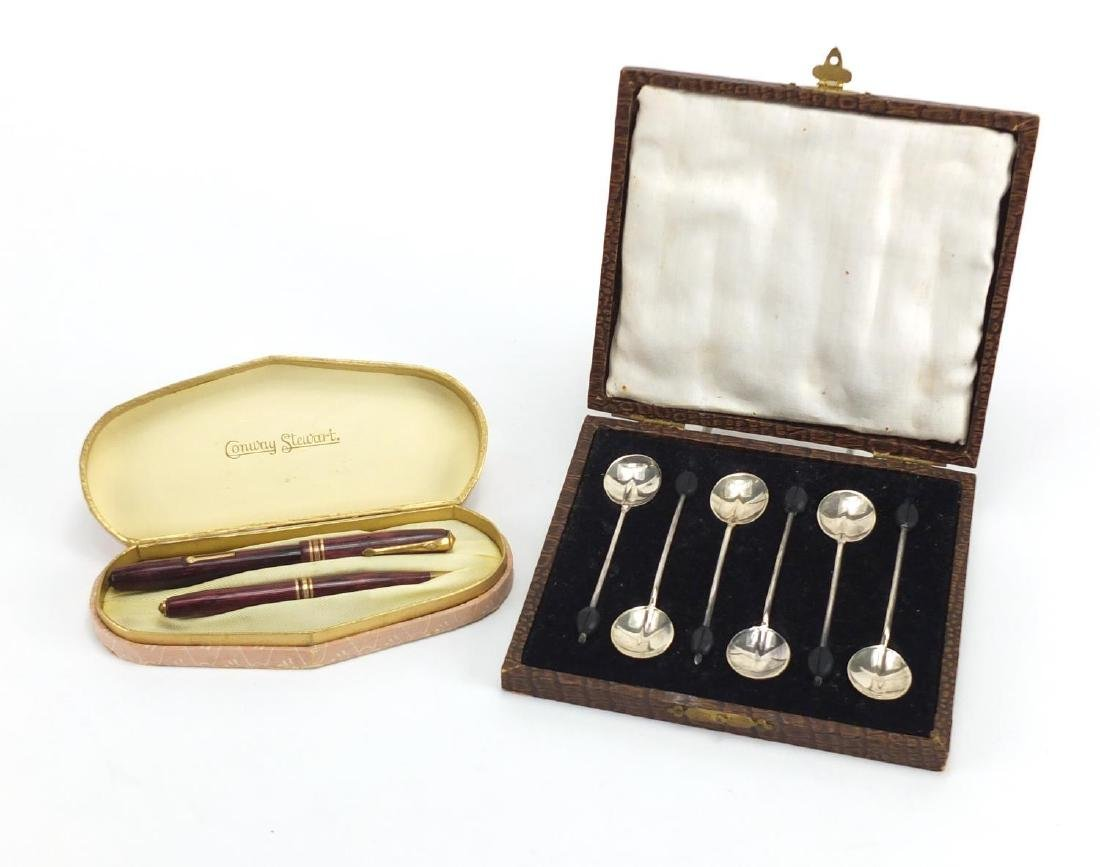 Set of six silver coffee bean spoons, together with a Conway Stewart 36 red marbleised fountain
