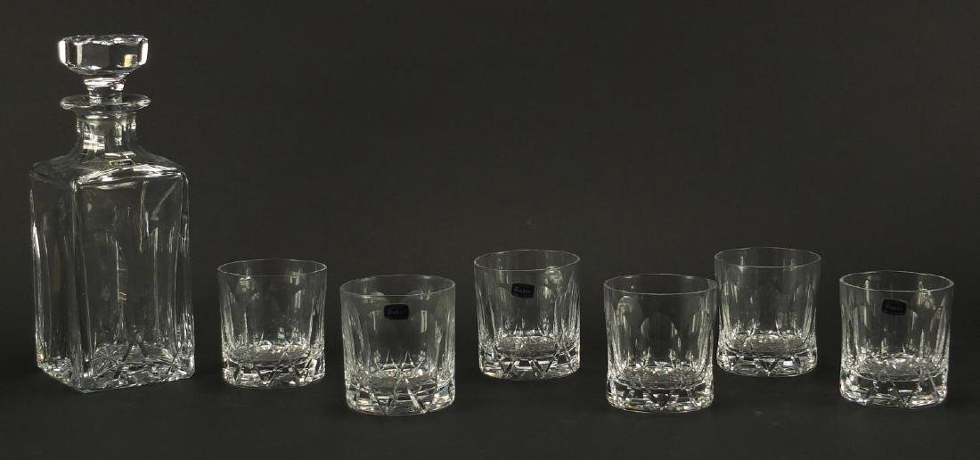 Tudor crystal whiskey decanter and six tumblers, with paper label, the largest 26cm high