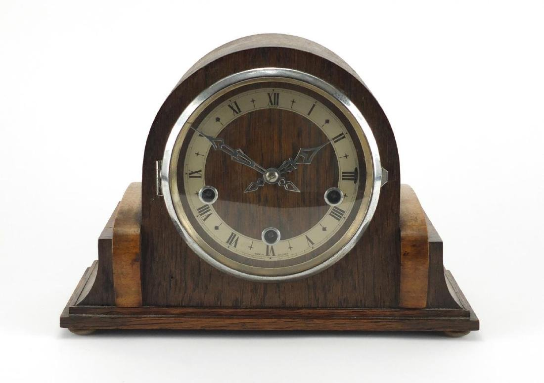 Enfield oak cased Westminster chiming mantel clock, with silvered chapter ring and Roman numerals,