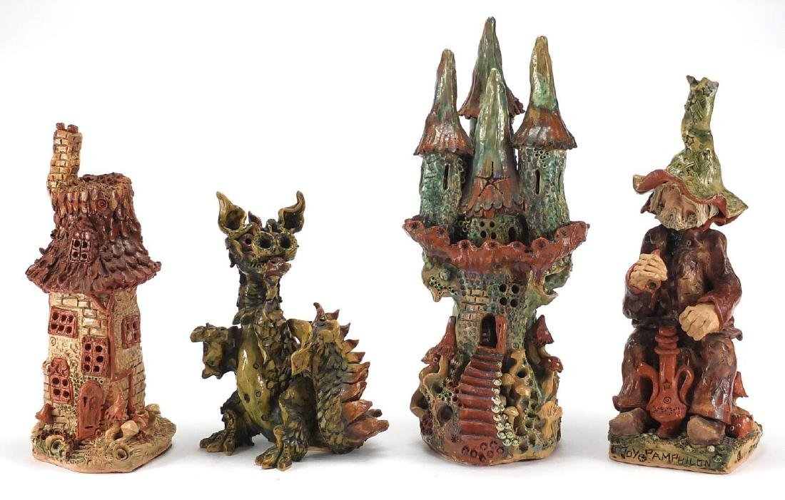 Four mythical studio pottery sculptures by Joy Pamphilon, comprising two buildings, a wizard and