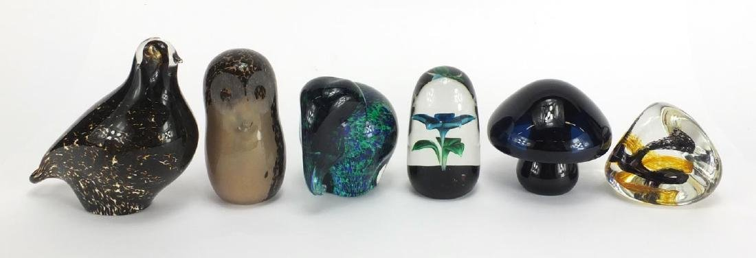 Six paperweights including four Wedgwood, Caithness Pebble and one of a flower with part label to