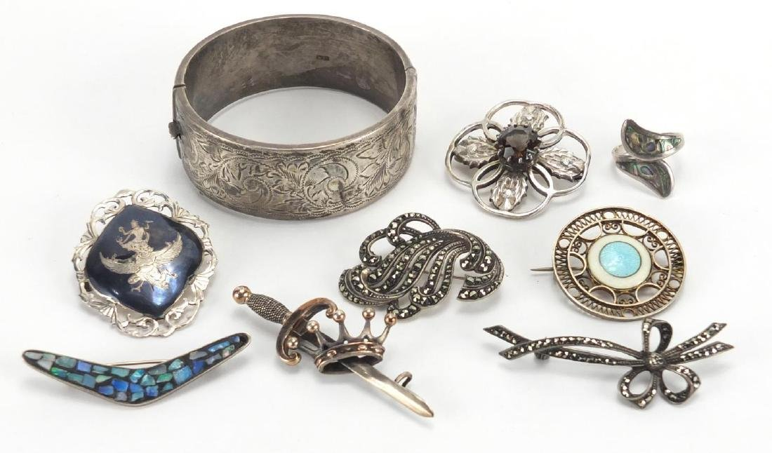 Mostly silver jewellery including enamel brooch, Siam and Marcasite brooches and a bangle with