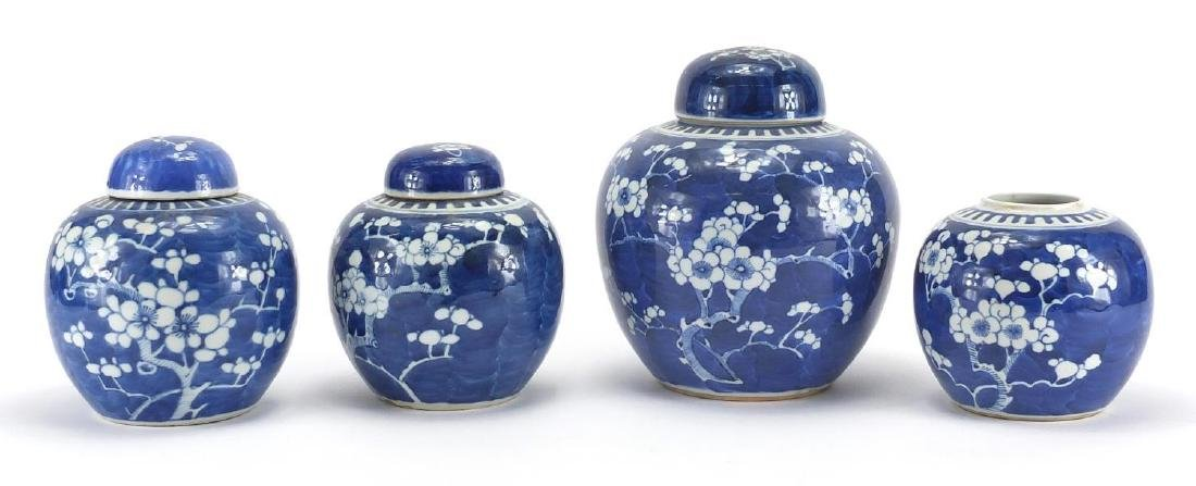 Four Chinese blue and white porcelain ginger jars, hand painted with Prunus flowers, the largest
