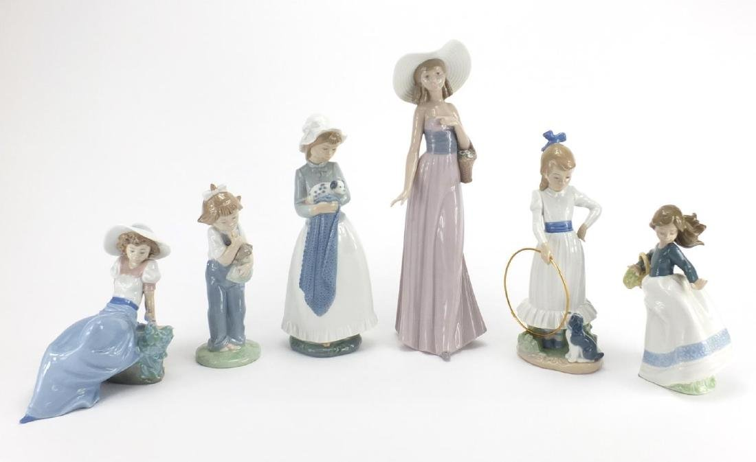 Six Nao figurines including a girl holding a puppy and a girl sat with a bird, the largest 32cm high