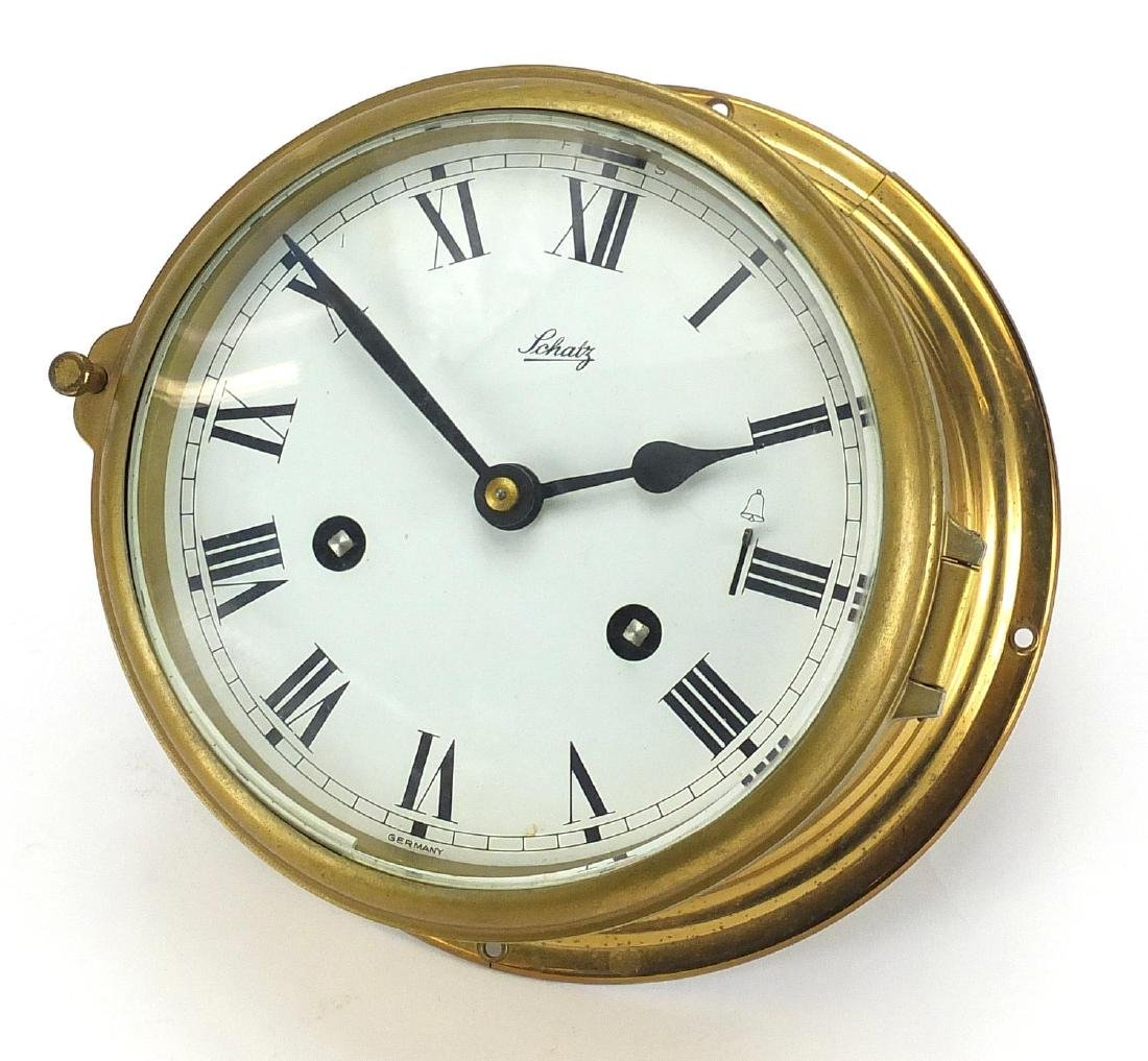 Schatz brass cased bulk head design clock with Roman numerals, dial 15.5cm in diameter