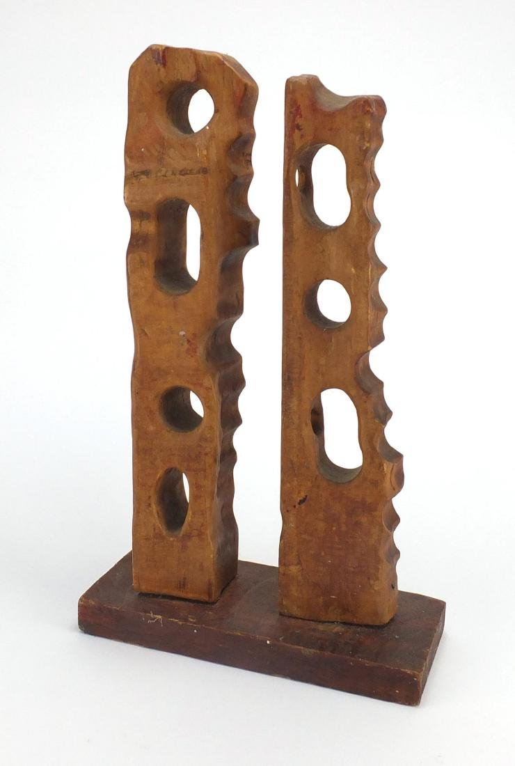 Modernist carved wood sculpture on a rectangular plinth base, bearing incised marks, overall 41cm