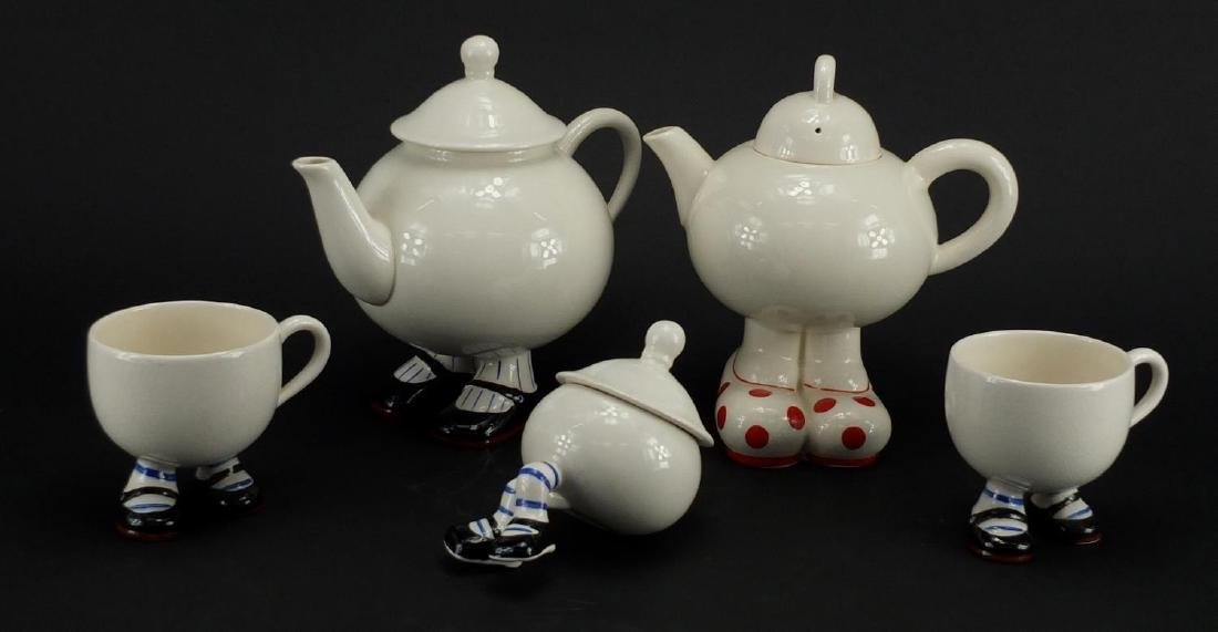 Carlton Ware Lustre design walking ware comprising two teapots, two cups and a lidded sugar, the