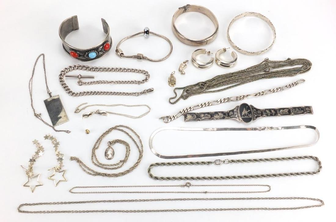 Silver and white metal jewellery including a Siam bracelet, bangle with floral chased decoration,