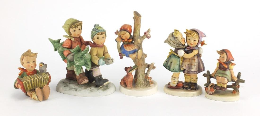 Five Goebel Hummel figures including Tree Trimming Time, the largest 17cm high