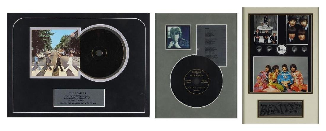Three The Beatles and John Lennon framed displays including Abbey Road, limited edition 65/500 and