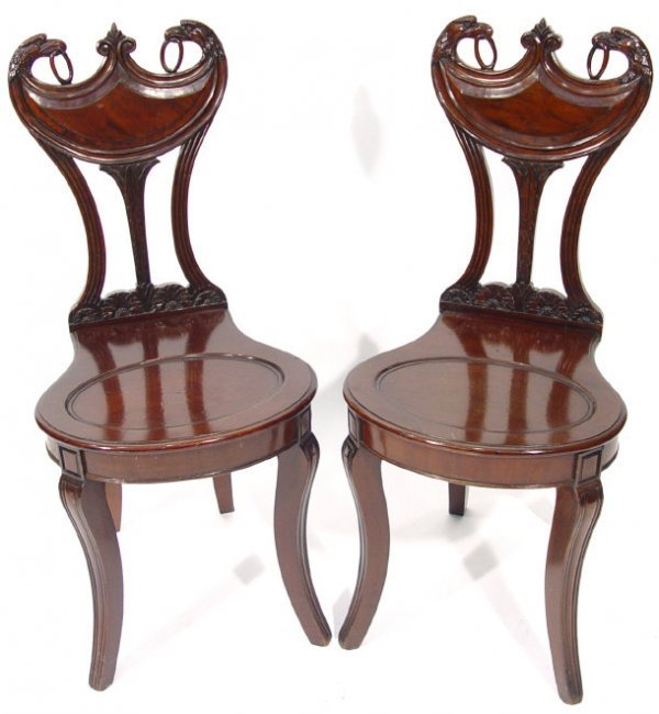 2: Pair of Regency mahogany hall chairs with eagle and