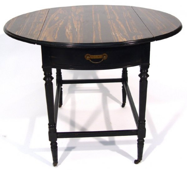 7: Victorian amboyna Pembroke table fitted with a drawe