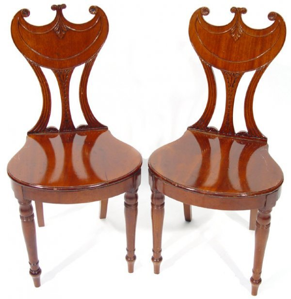 8: Pair of Regency mahogany hall chairs with acanthus a