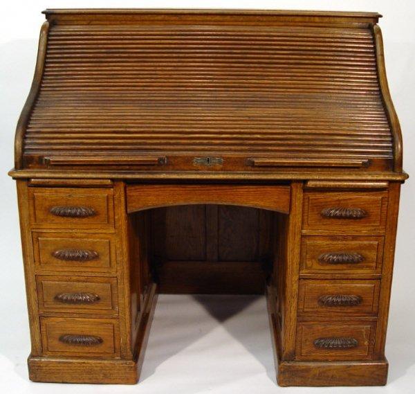 9: 1920s oak rolltop bureau fitted with an arrangement