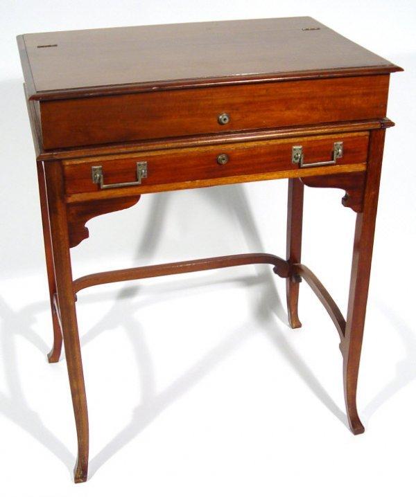 12: Edwardian mahogany desk, the hinged cantilever lid