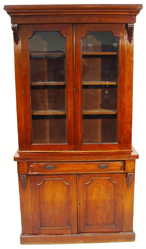 13: Victorian walnut bookcase, the moulded cornice abov