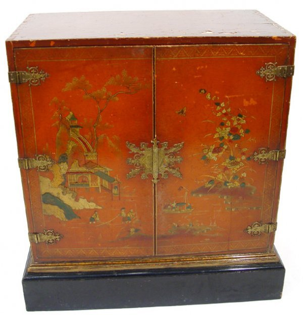 15: Scarlet lacquer two door cabinet decorated in the c