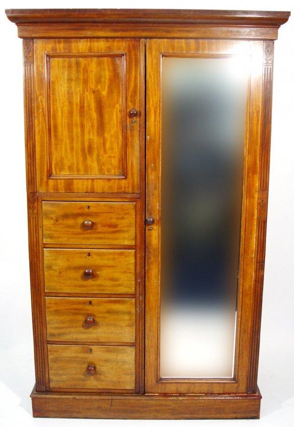 16: Victorian mahogany compactum wardrobe, the moulded