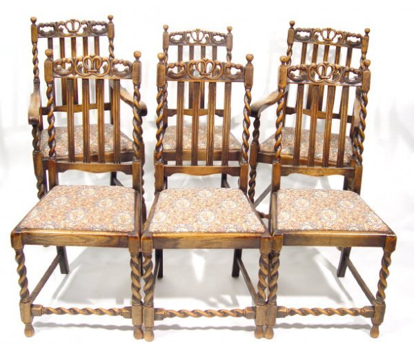 22: Set of six 1920s oak dining chairs to include two c