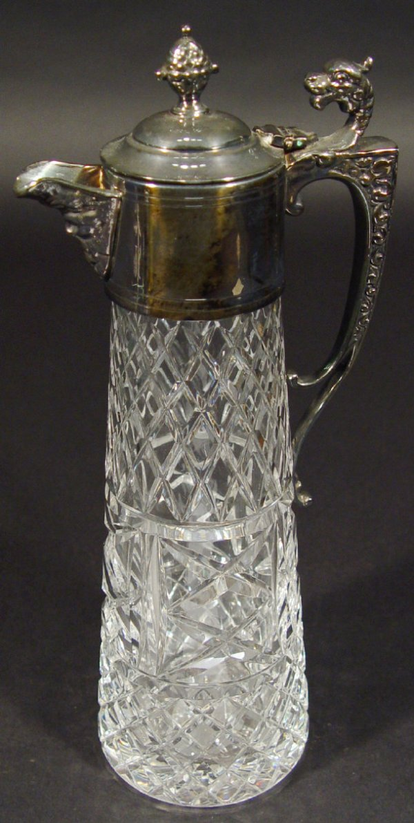 1201: Cut glass claret jug with silver plated dragon de