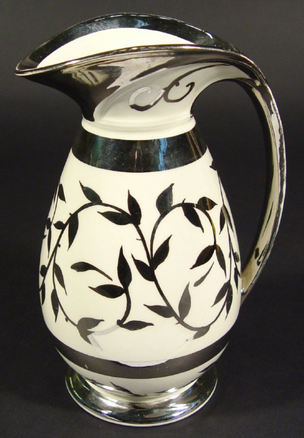 1202: Myott china jug decorated with silver lustre leav