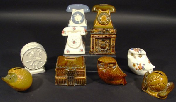 1208: Ten Szeiler china money banks of novelty shape, s