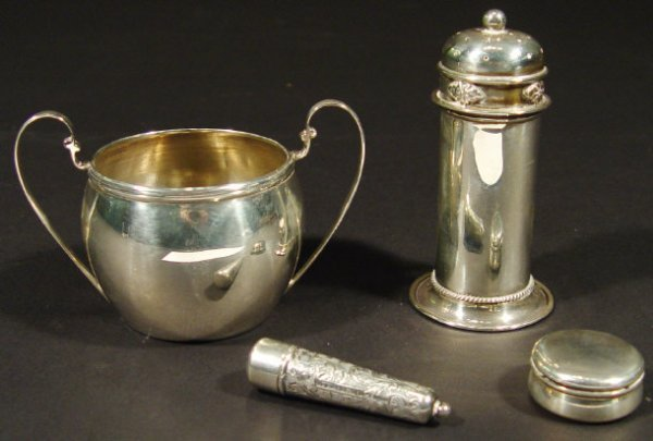 1340: Four silver items comprising a cylindrical sugar