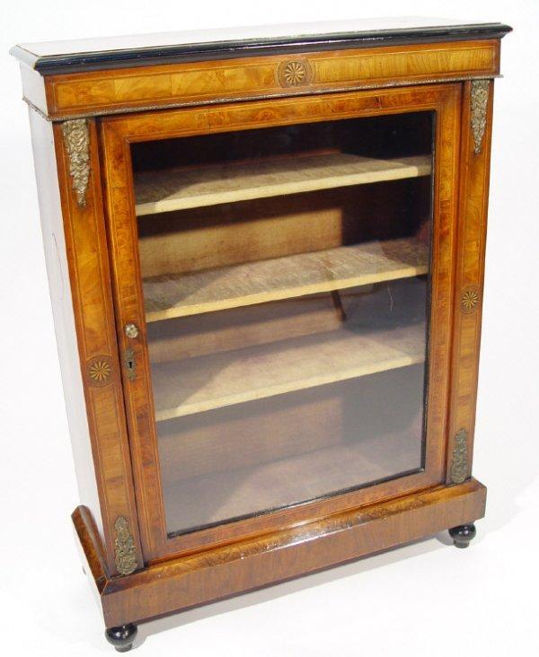 12: Victorian inlaid walnut bookcase, the glazed door e