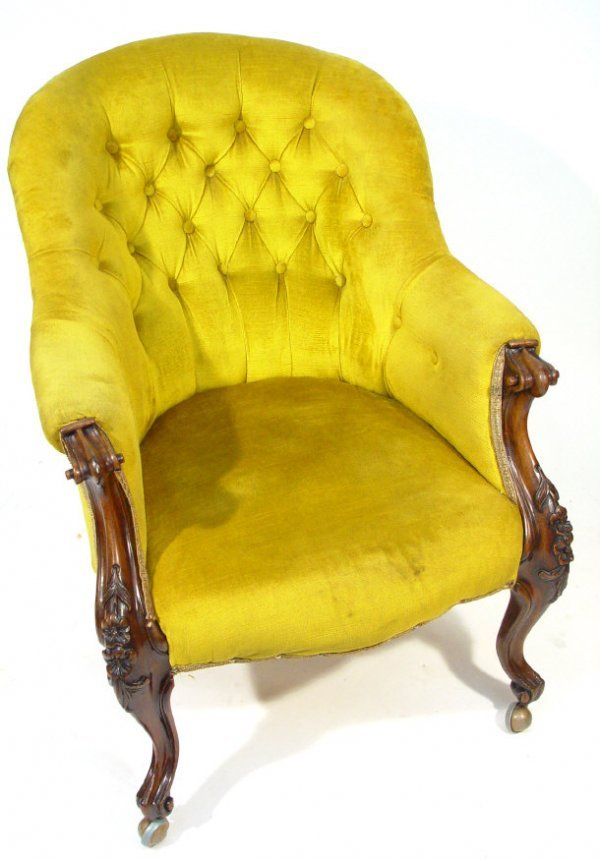 17: Victorian mahogany framed armchair with scroll arms