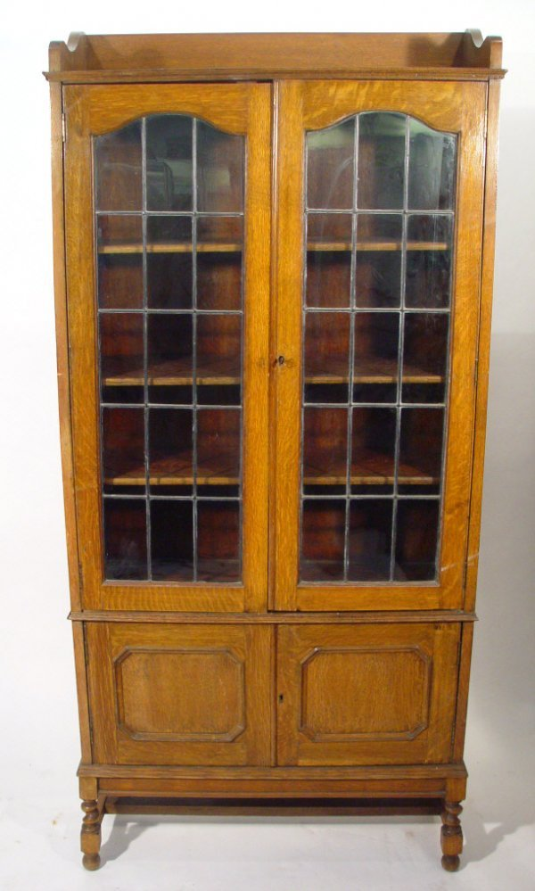 21: Edwardian oak bookcase, fitted with two leaded glaz