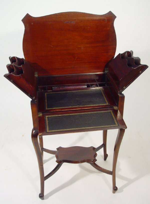 24: Mahogany writing table, the hinged lid opening to r