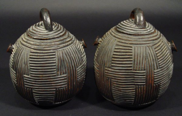 669: Two hardwood tribal art storage canisters and cove