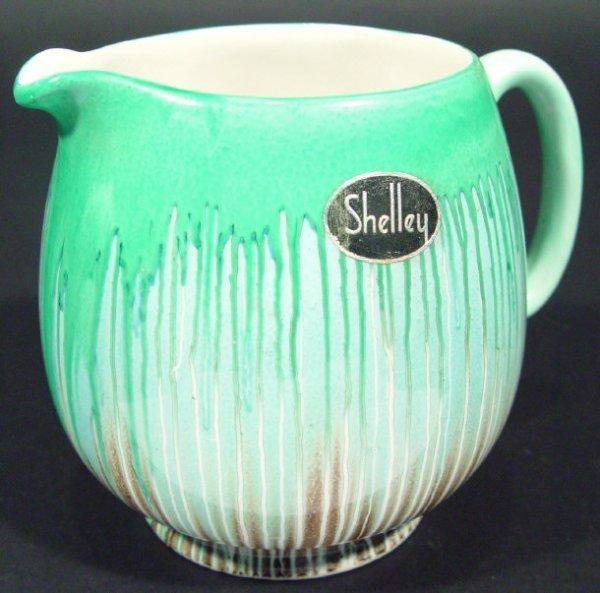 1224: Art Deco Shelly china jug decorated with a green