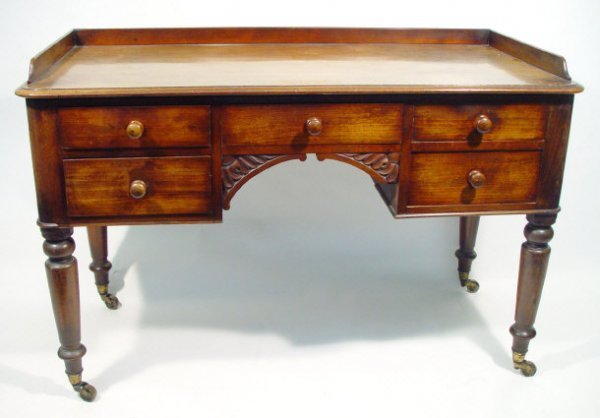 5: Victorian mahogany writing table, the galleried top