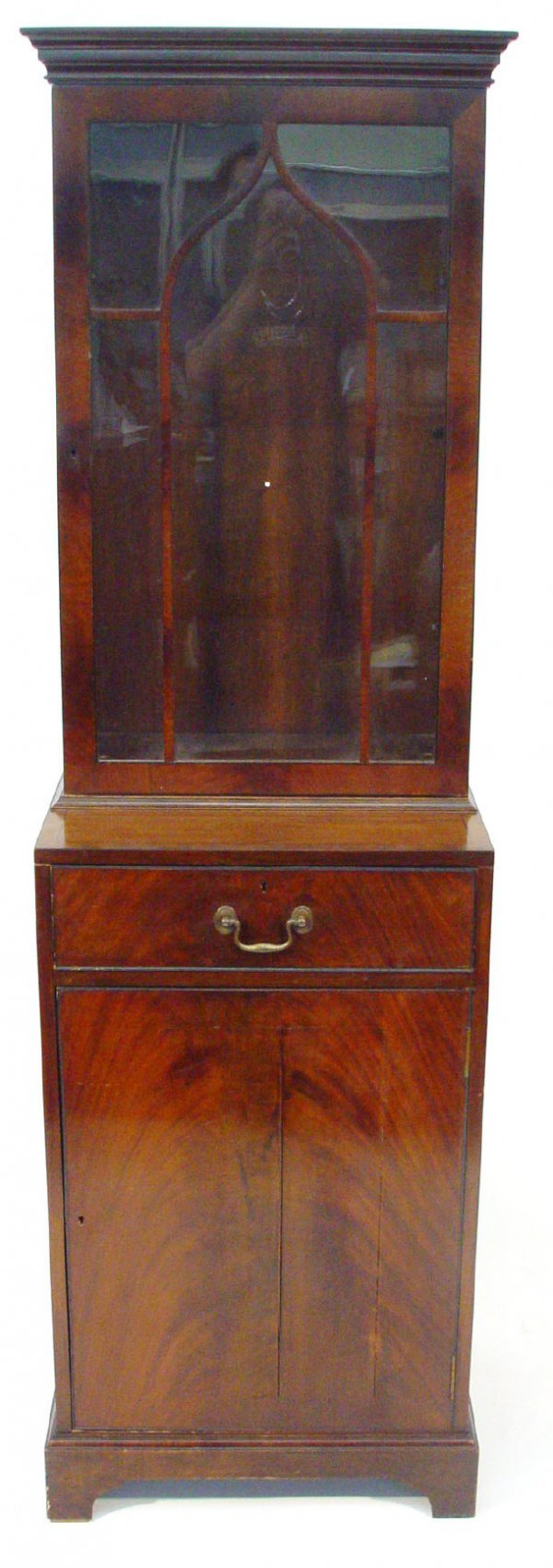 9: Mahogany pier cabinet, the moulded cornice above a g