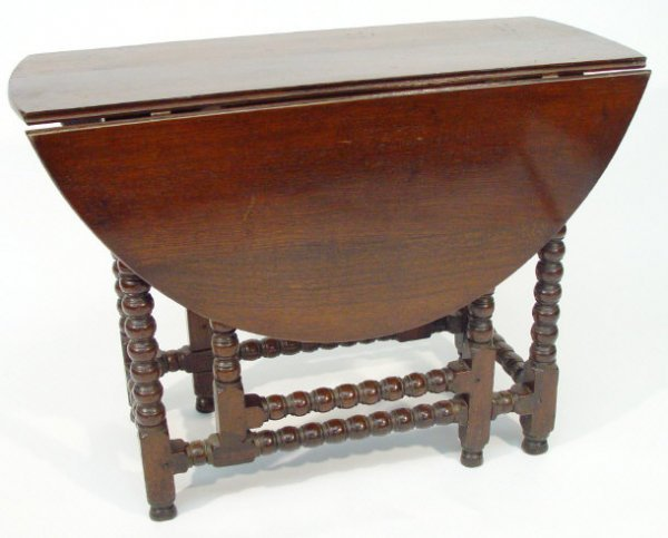 20: 1920s oak D-end gateleg table with turned supports