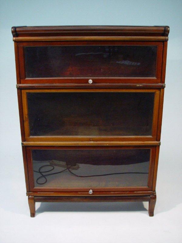 22: Globe-Wernicke mahogany three section bookcase with